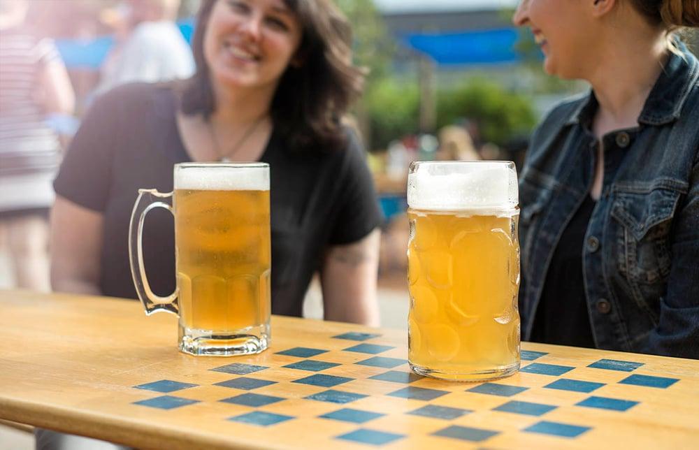 Branded glass tankards in the beer garden